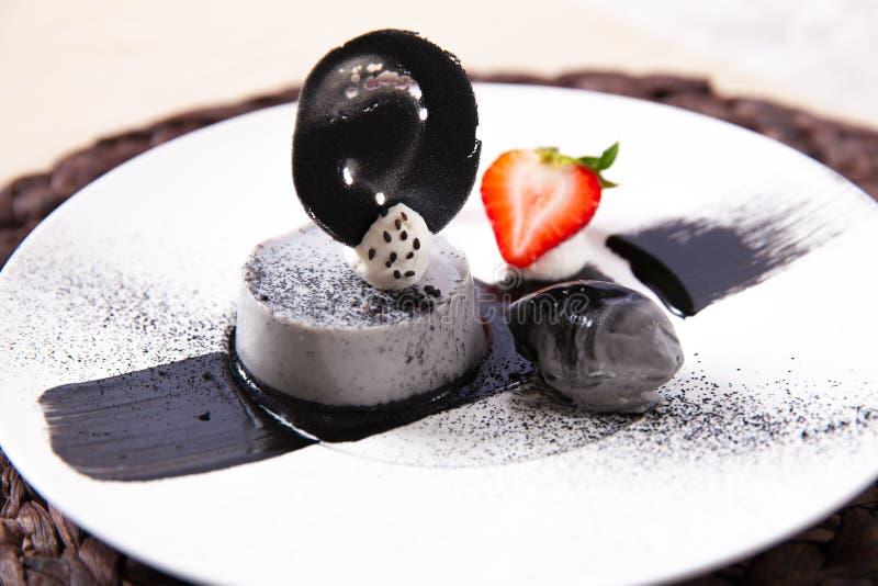 Panna cotta. Black sesame pudding and ice cream stock photos