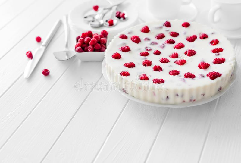 Panna cotta raspberries on a wooden table royalty free stock photography