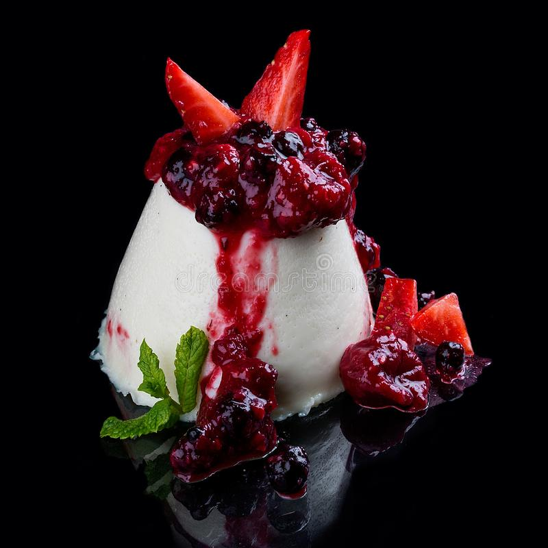 """Panna-cotta from a white chocolate with the seed of vanilla under a confiture """"Five berries stock photo"""
