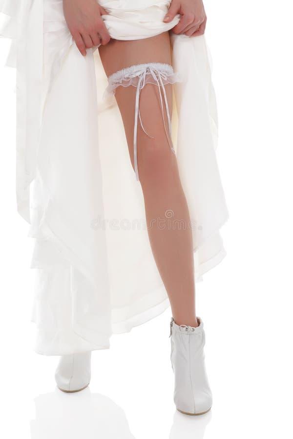 Panna młoda pokazywać jej nogę obraz royalty free