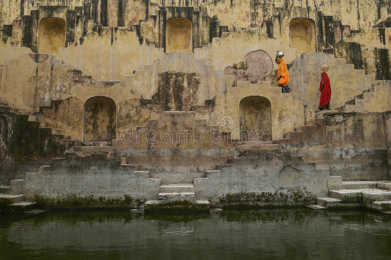 Panna Meena Ka Khun. Two Local Women sitting in the stepwells of Chand Baori, in Jaipur, India. It was built as a monument to the goddess of joy and happiness stock photography