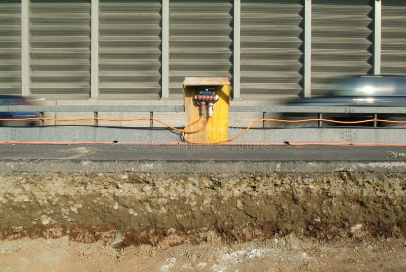 Panneau électrique à une construction photographie stock