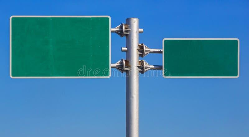 Panneau blanc de panneau routier photos stock
