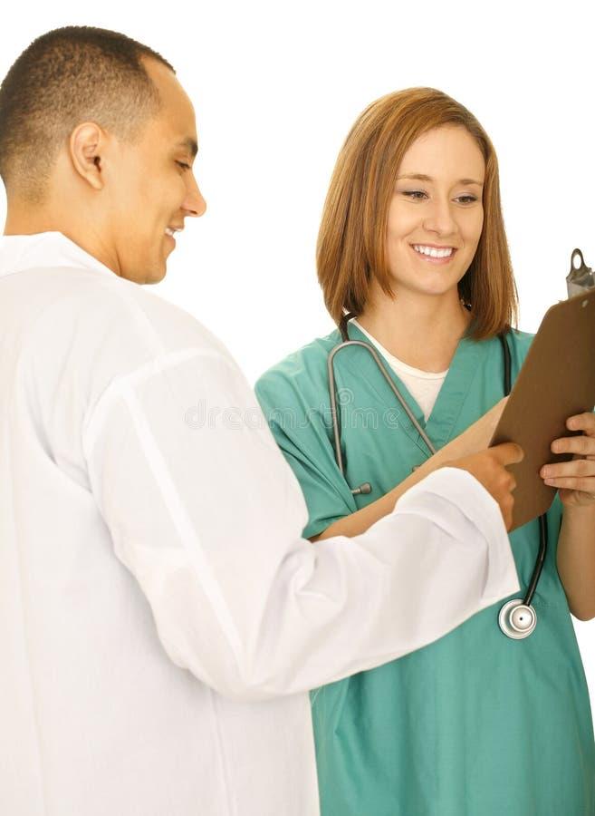 Panneau de clip de fixation de médecin et d'infirmière photos stock