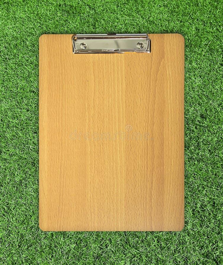 Panneau de clip sur l'herbe photographie stock