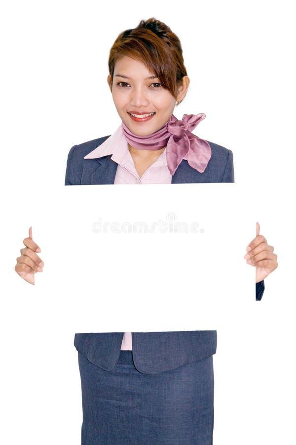 Panneau de prise de femme d'affaires photo stock