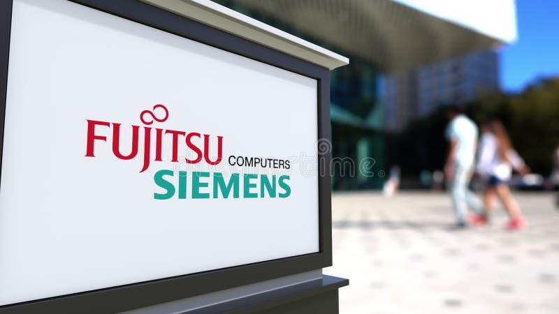 Panneau de signage de rue avec le logo d'ordinateurs de Fujitsu Siemens Centre brouillé de bureau et fond de marche de personnes  illustration stock