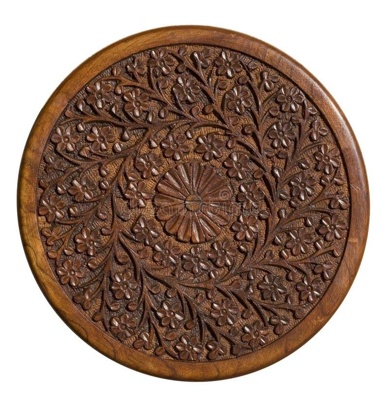 Panneau en bois circulaire découpé avec la conception florale images libres de droits