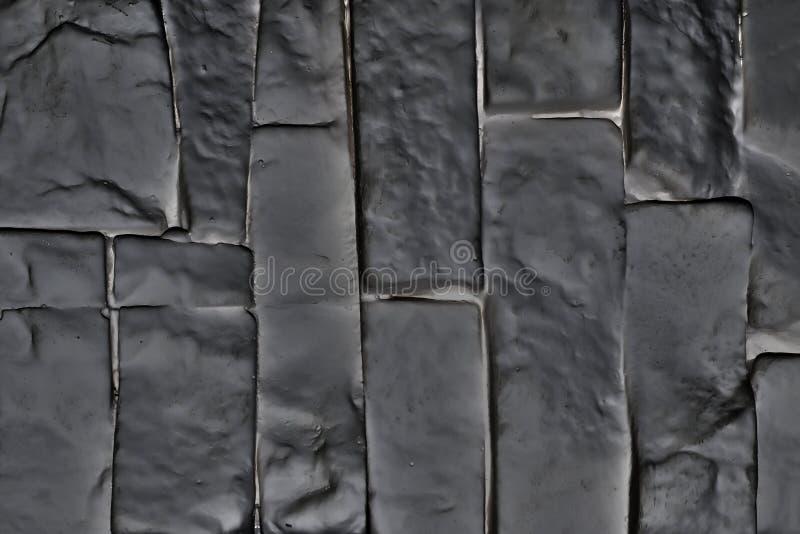 Panneau en plastique de mur de briques gris-foncé verticalement orienté images libres de droits