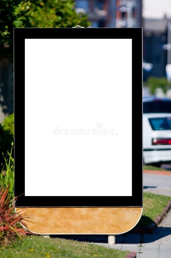 Panneau-réclame blanc sur la rue image libre de droits