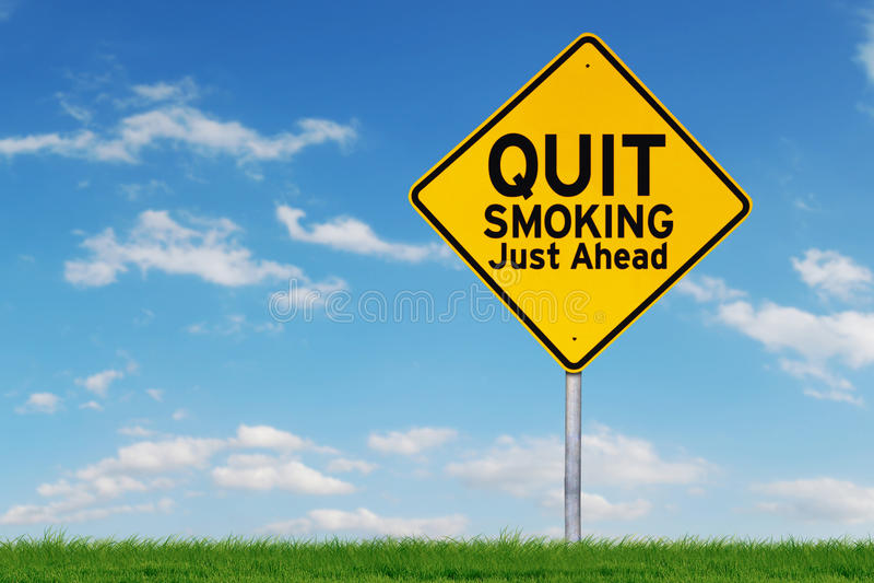 Panneau routier jaune avec le texte du tabagisme stoppé photographie stock libre de droits