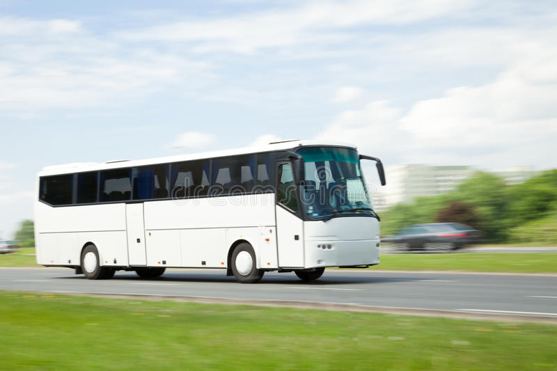 Panning image of tour bus. In intentional motion blur stock photos