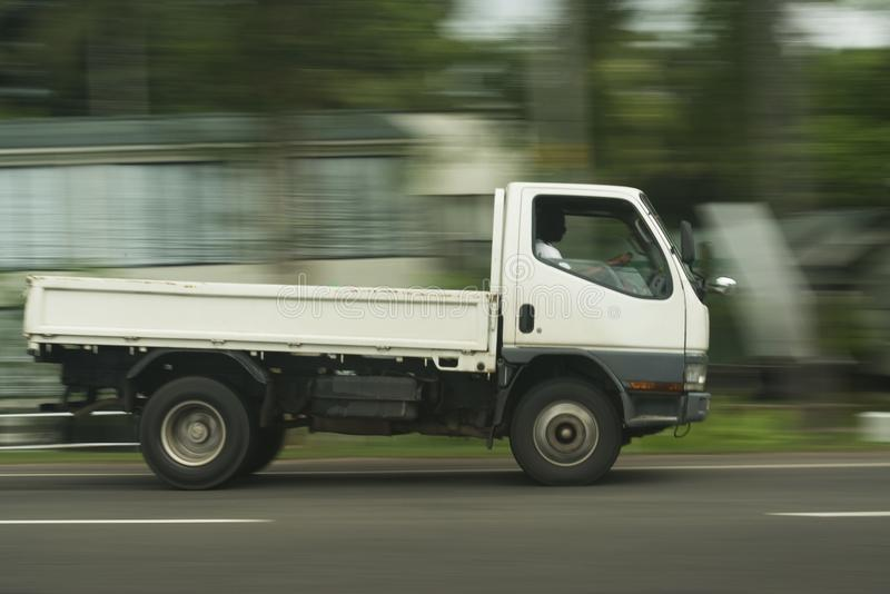 Truck in motion. A panning image of a truck in motion royalty free stock photography