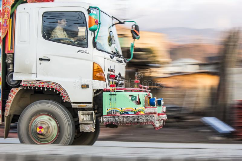 Panning Photography of the truck. Panning photography example shot of a truck moving on Karakurram Highway Mansehra stock image