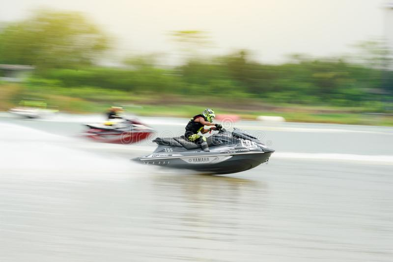 Panning short of jet ski for motion blur action.Thailand Jet ski pro tour #3, Udonthani, Thailand - May 26, 2019. :Unidentified. Competitor is riding jet ski stock images