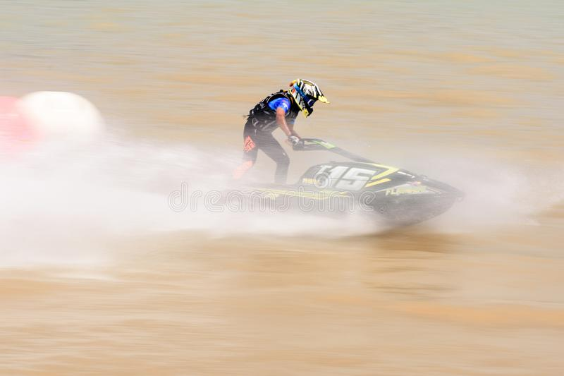 Panning short of jet ski for motion blur action.Thailand Jet ski pro tour #3, Udonthani, Thailand - May 26, 2019. :Unidentified. Competitor is riding jet ski stock photo