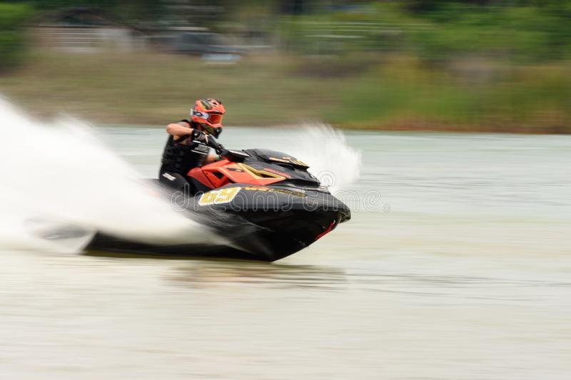 Panning short of jet ski for motion blur action.Thailand Jet ski pro tour #3, Udonthani, Thailand - May 26, 2019. :Unidentified. Competitor is riding jet ski royalty free stock photo