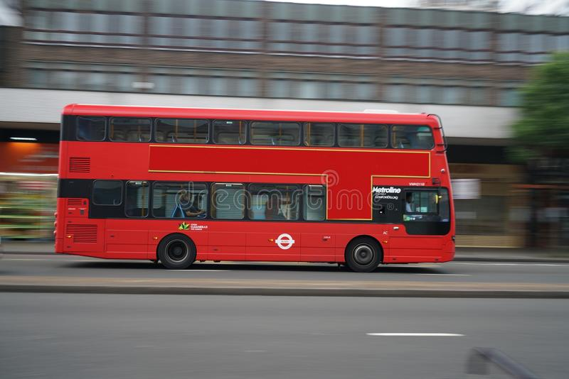 Panning shot of double-decker bus running on Edgware Road early in the morning. London,United Kingdom-May 30, 2017:A double-decker bus is a bus that has two royalty free stock image