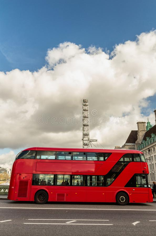 Panning shot of red double decker bus in London.  royalty free stock photos
