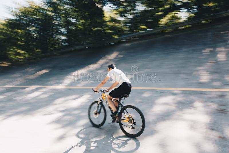 Panning view of a Biker along Path in old racetrack, speedway parabolic in the Autodrome of Monza - Lombardy - Italy. Panning view of a Biker along Path in old stock photos