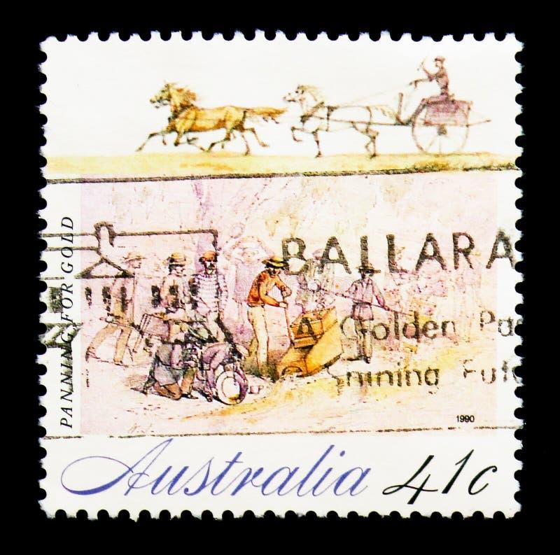 Panning voor gouden, Koloniale Ontwikkeling serie, circa 1990 royalty-vrije stock foto
