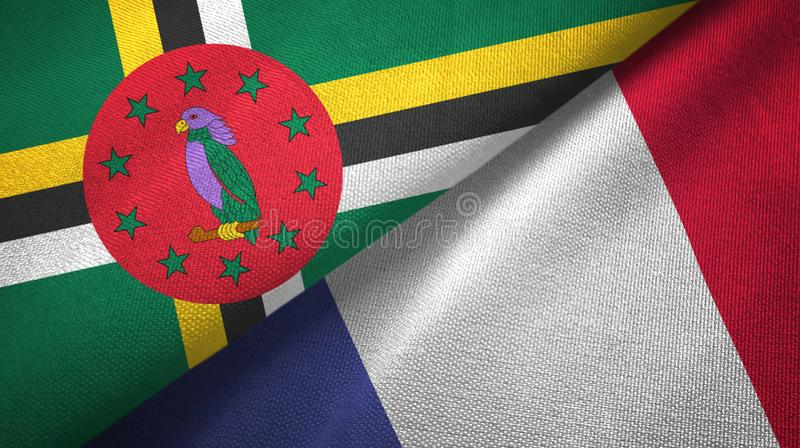 Panno del tessuto delle bandiere della Francia e della Dominica due, struttura del tessuto fotografie stock