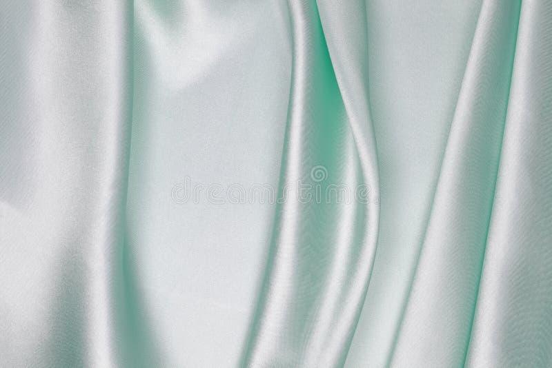 Panno di seta verde chiaro di fondo astratto ondulato fotografie stock libere da diritti