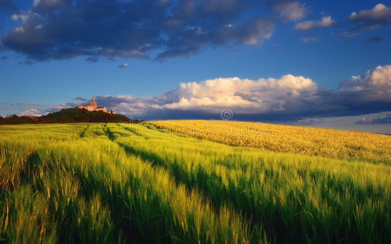 Pannonhalma Abbey with wheat and rapeseed field, Hungary. The Benedictine Pannonhalma Archabbey or Territorial Abbey of Pannonhalma is the most notable landmark stock photos