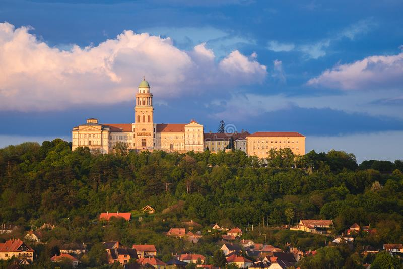 Pannonhalma Archabbey in Hungary. Pannonhalma Archabbey with rainy clouds in Hungary stock photo