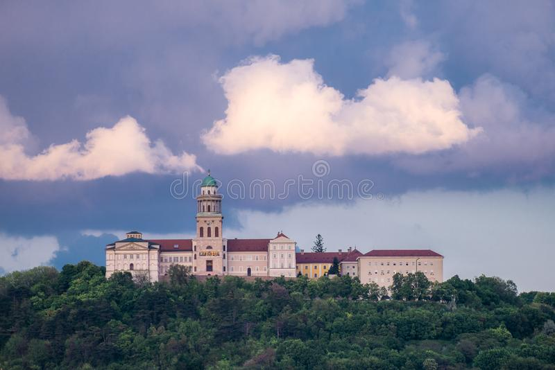 Pannonhalma Archabbey in Hungary. Pannonhalma Archabbey with rainy clouds in Hungary royalty free stock photography