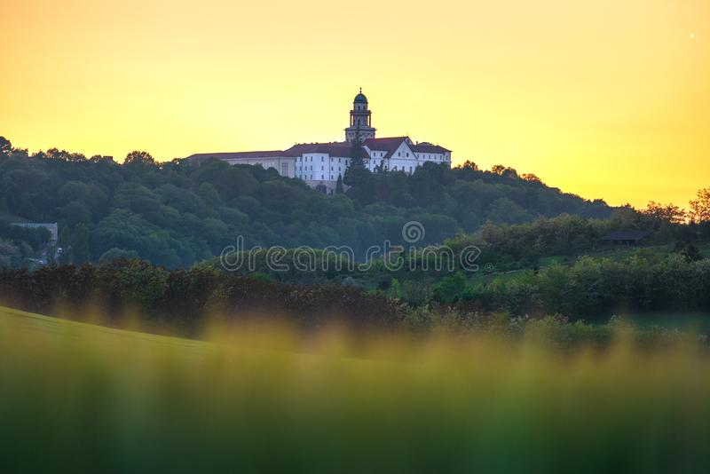 Pannonhalma Archabbey with wheat field on sunset. Time in spring royalty free stock photos