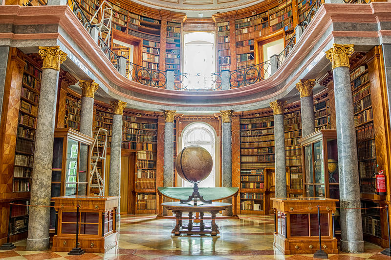Pannonhalma library interior in Hungary. Pannonhalma, Hungary - June 27, 2016: Pannonhalma Abbey library interior in Hungary. UNESCO's World Heritage Site stock photo