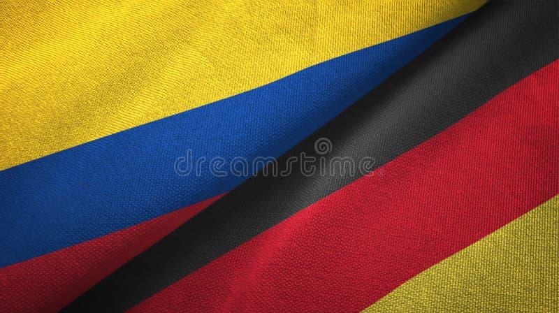 Pano de matéria têxtil das bandeiras de Colômbia e de Alemanha dois, textura da tela ilustração royalty free