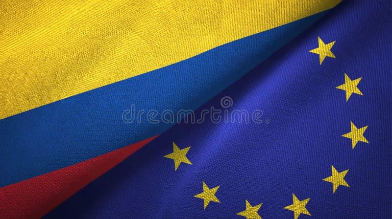 Pano de matéria têxtil das bandeiras de Colômbia e da União Europeia dois, textura da tela ilustração stock