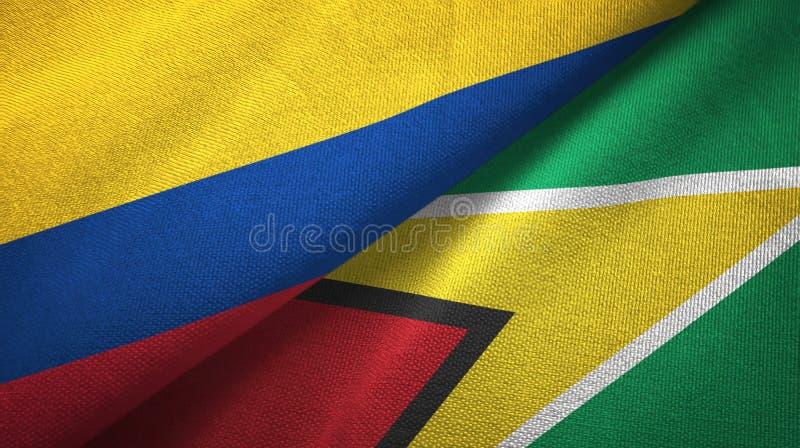 Pano de matéria têxtil das bandeiras de Colômbia e de Guiana dois, textura da tela ilustração stock
