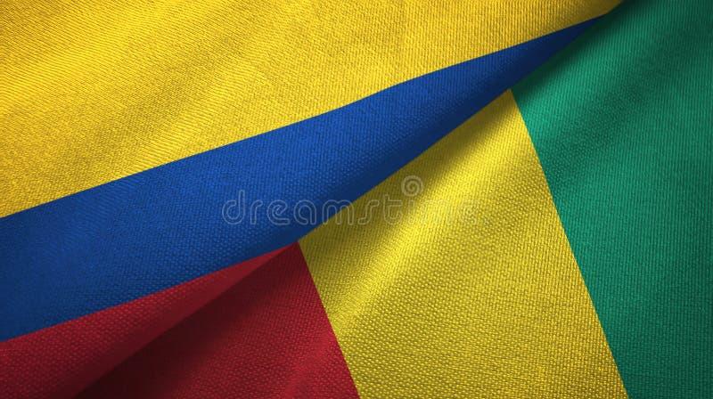 Pano de matéria têxtil das bandeiras de Colômbia e de Guiné dois, textura da tela ilustração stock