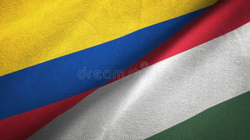 Pano de matéria têxtil das bandeiras de Colômbia e de Hungria dois, textura da tela ilustração royalty free