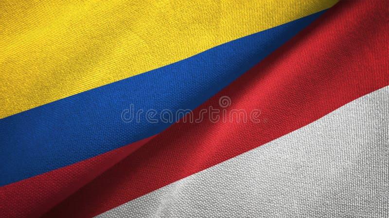 Pano de matéria têxtil das bandeiras de Colômbia e de Indonésia dois, textura da tela ilustração stock