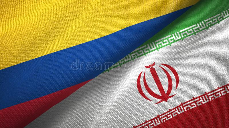 Pano de matéria têxtil das bandeiras de Colômbia e de Irã dois, textura da tela ilustração stock