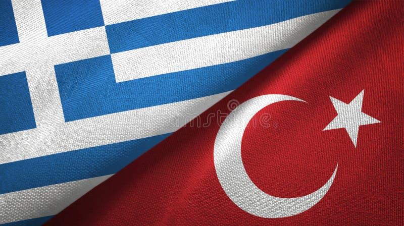 Pano de matéria têxtil das bandeiras de Grécia e de Turquia dois, textura da tela ilustração stock