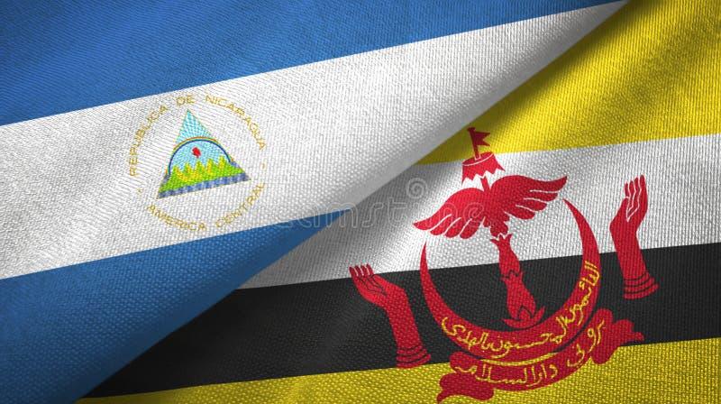 Pano de matéria têxtil das bandeiras de Nicarágua e de Brunei Darussalam dois fotografia de stock royalty free