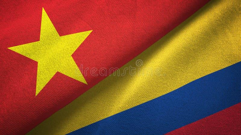 Pano de matéria têxtil das bandeiras de Vietname e de Colômbia dois, textura da tela ilustração royalty free