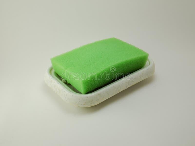 Pano, esponja, líquido de limpeza em um podstvka Eu removo, datilografo que mim foto de stock