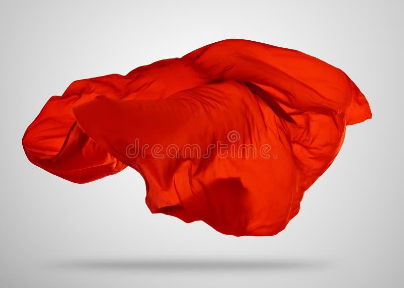 Pano vermelho elegante liso no fundo cinzento foto de stock royalty free