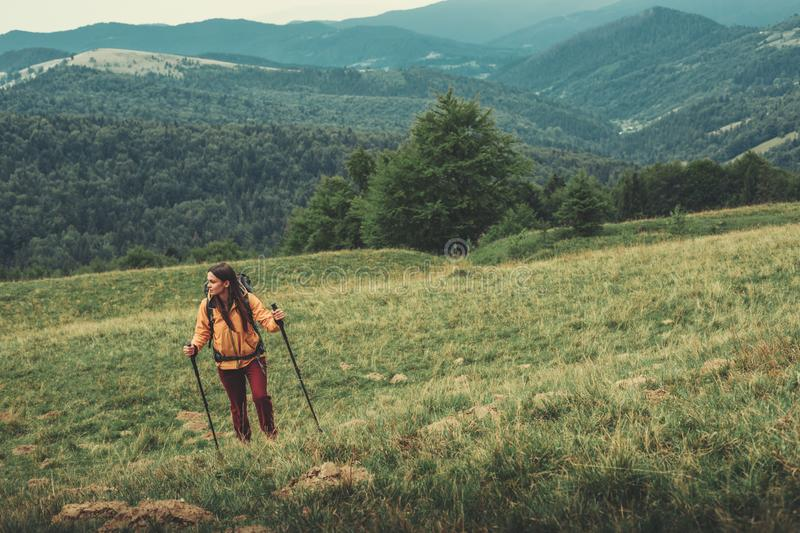 Pano view of mountains with an active female traveler royalty free stock image