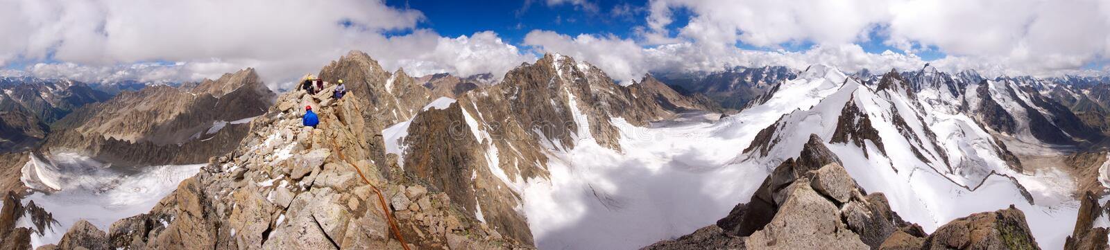Panorama 360 of Caucasian mountains with climbers royalty free stock photography