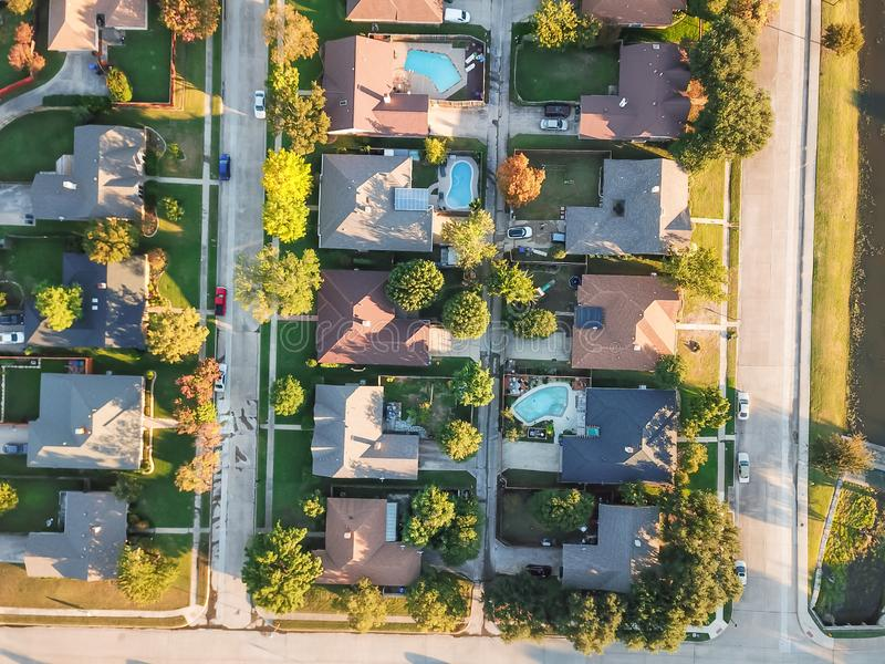 Panoramic residential subdivision with swimming pool in fall season near Dallas, Texas. Panorama aerial vertical view residential houses with swimming pool in royalty free stock photos