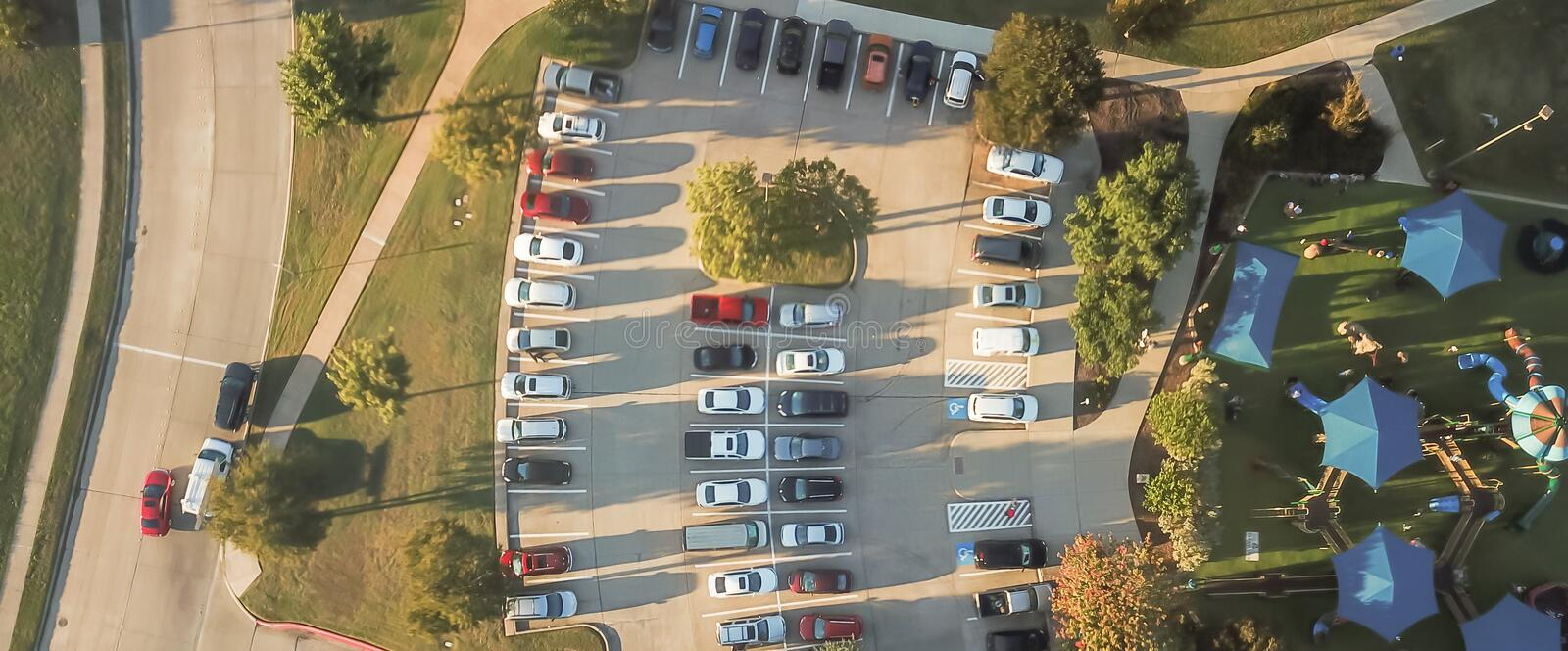 Panoramic top view crowed parking lots near community playground in Texas, America royalty free stock photo
