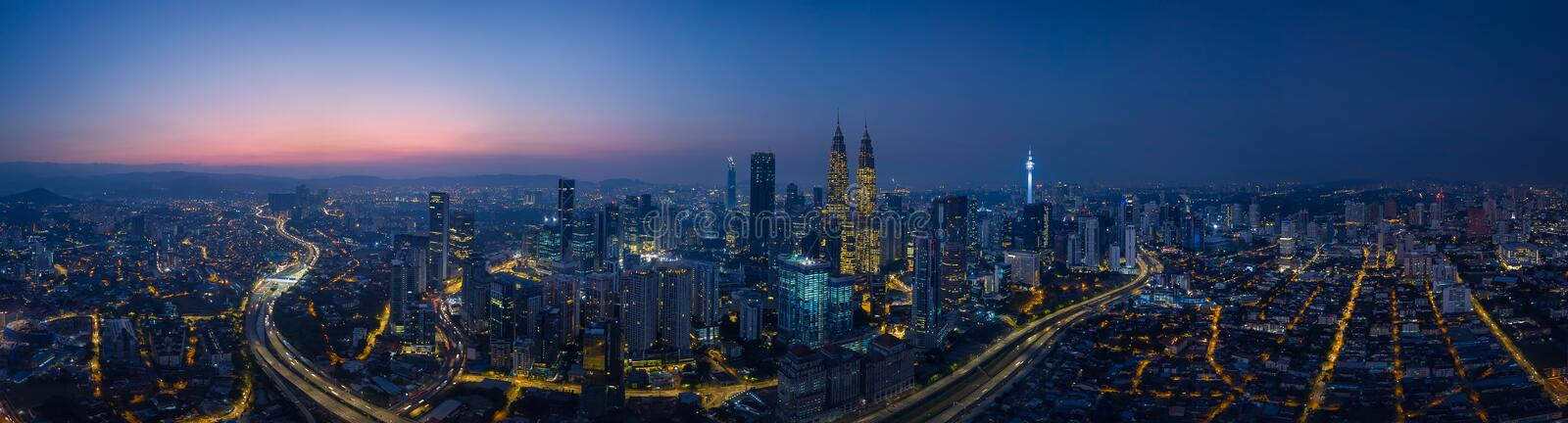 Panorama aerial view in the middle of Kuala Lumpur cityscape skyline. Night scene before sunrise , Malaysia stock photography