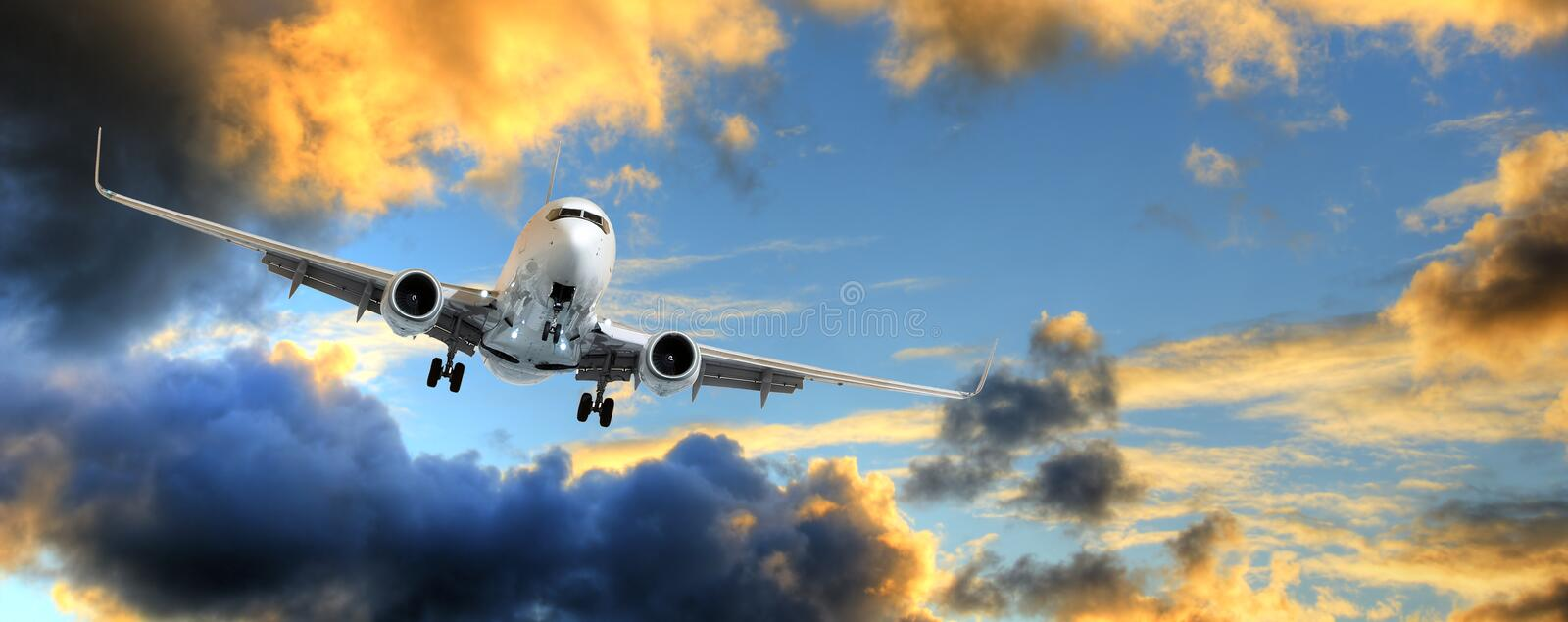 Panorama of airplane in sunset sky stock image